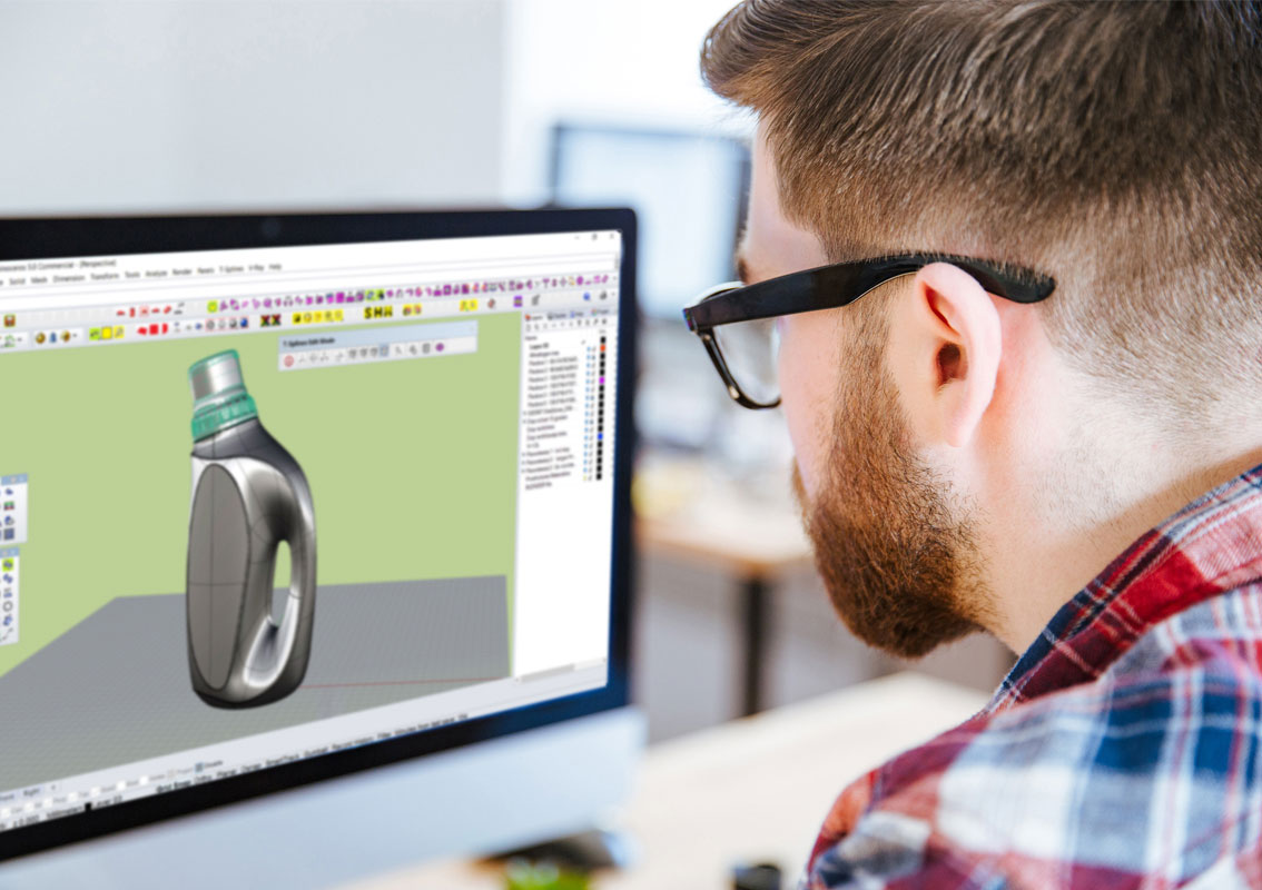 Designer creating a CAD model on his computer of a washing liquid bottle