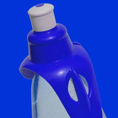 Bright blue hands-free drinking spout on water bottle on bright blue background