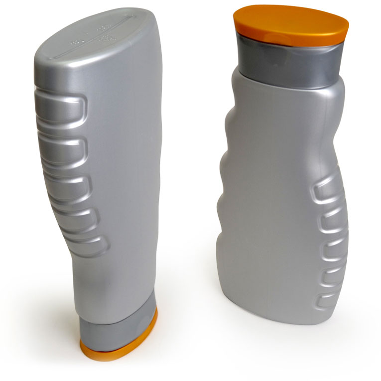 Two grey showergel bottles with orange caps, one standing upside down